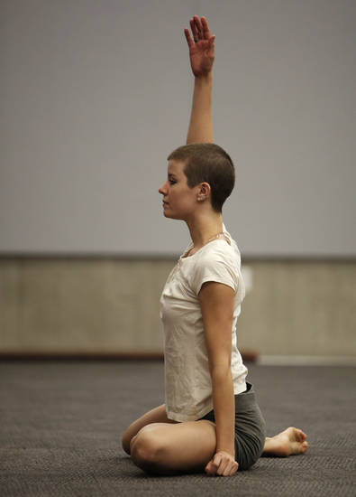 Emily Dawson,  with Perpetual Motion dance company, perform at the  Patience S. Latting Northwest Library in Oklahoma City.  Photo by Garett Fisbeck, The Oklahoman <strong>Garett Fisbeck - Garett Fisbeck</strong>
