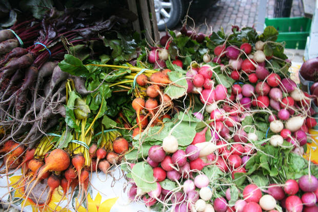 Winter vegetables at the Ann Arbor Farmers Market include carrots, beets and radishes. <strong>DAVE CATHEY - THE OKLAHOMAN</strong>