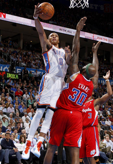 Oklahoma City's Russell Westbrook (0) goes to the basket beside Los Angeles' Reggie Evans (30) during the NBA basketball game between the Oklahoma City Thunder and the Los Angeles Clippers at Chesapeake Energy Arena in Oklahoma City, Wednesday, April 11, 2012. Photo by Bryan Terry, The Oklahoman