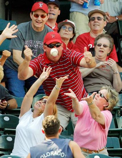 Fans try to catch a foul ball during the Big 12 Tournament college baseball game between Missouri and Texas Tech at the Bricktown Ballpark in Oklahoma City, Friday, May 22, 2009. Texas Tech won, 4-2. Photo by Nate Billings, The Oklahoman