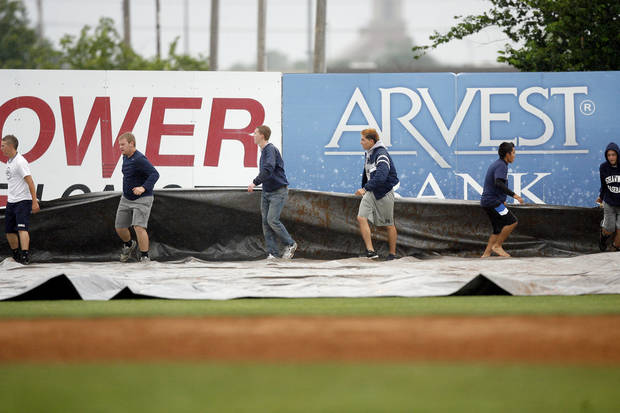 The tarp is pulled out following the 4A high school baseball playoff game between Hilldale and Anadarko at Shawnee High School in Shawnee, Okla., Friday, May 11, 2012. Photo by Sarah Phipps, The Oklahoman