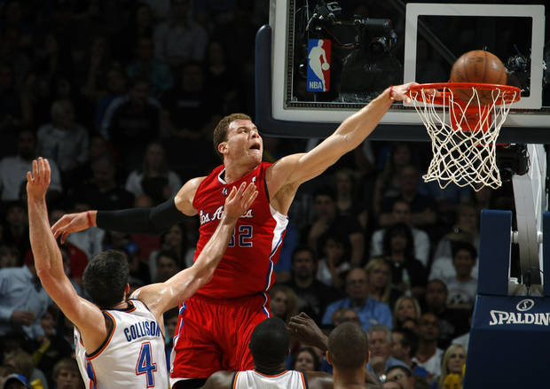 Los Angeles Clippers' Blake Griffin (32) dunks the ball over Oklahoma City's Nick Collison (4) during the NBA basketball game between the Oklahoma City Thunder and the Los Angeles at the Oklahoma City Arena, Wednesday, April 6, 2011. Photo by Bryan Terry, The Oklahoman