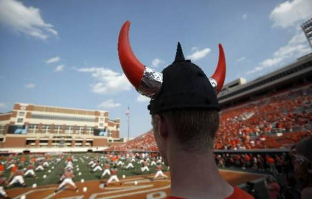 Mark Denker watches OSU warm up during a college football game between the Oklahoma State Cowboys (OSU) and the University of Louisiana at Lafayette (ULL) Ragin' Cajuns at Boone Pickens Stadium in Stillwater, Okla., Saturday, Sept. 3, 2011. Photo by Sarah Phipps, The Oklahoman ORG XMIT: KOD