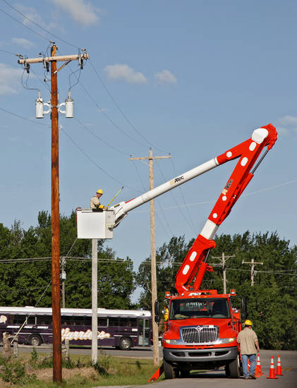 OG&E linemen repair power lines damaged by tornados north of El Reno, Wednesday, May 25, 2011. Photo by Chris Landsberger, The Oklahoman