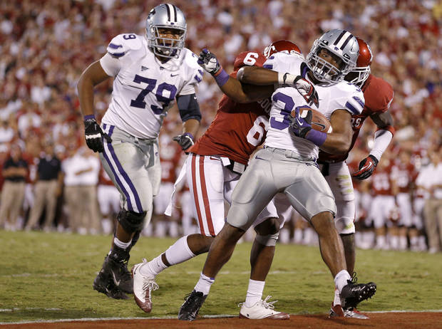 Kansas State's John Hubert (33) scores a touchdown as Oklahoma's Demontre Hurst (6) tries to bring him down during a college football game between the University of Oklahoma Sooners (OU) and the Kansas State University Wildcats (KSU) at Gaylord Family-Oklahoma Memorial Stadium, Saturday, September 22, 2012. Oklahoma lost 24-19. Photo by Bryan Terry, The Oklahoman