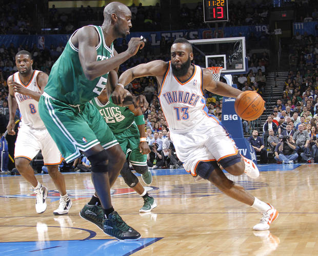 Oklahoma City Thunder guard James Harden (13) drives past Boston Celtics power forward Kevin Garnett (5) during the NBA basketball game between the Oklahoma City Thunder and the Boston Celtics at the Chesapeake Energy Arena on Wednesday, Feb. 22, 2012 in Oklahoma City, Okla.  Photo by Chris Landsberger, The Oklahoman