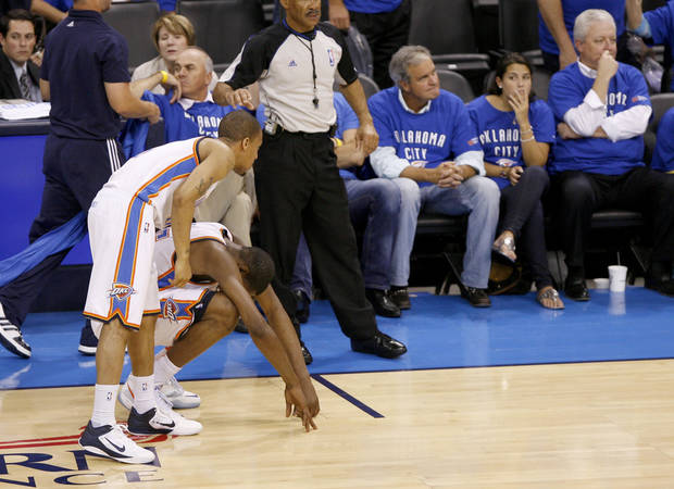 Oklahoma City's Eric Maynor (6) talks with Kevin Durant (35)as he sits on the court in overtime of game 4 of the Western Conference Finals in the NBA basketball playoffs between the Dallas Mavericks and the Oklahoma City Thunder at the Oklahoma City Arena in downtown Oklahoma City, Monday, May 23, 2011. Dallas won in overtime, 112-105. Photo by Bryan Terry, The Oklahoman