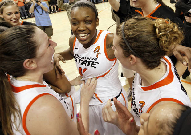 From left, OSU's Lindsey Keller (25), Toni Young (15) and Liz Donohoe (4) celebrate after the Women's NIT championship college basketball game between Oklahoma State University and James Madison at Gallagher-Iba Arena in Stillwater, Okla., Saturday, March 31, 2012. OSU won, 75-68. Photo by Nate Billings, The Oklahoman