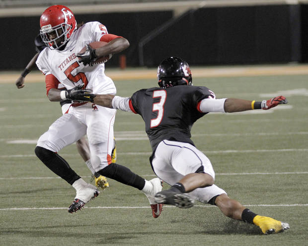 Carl Albert's Bryan Williams (5) runs past East Central's Deontre Youngblood (3) during the Class 5A Oklahoma state championship football game between Carl Albert High School and Tulsa East Central High School at Boone Pickens Stadium on Saturday, Dec. 1, 2012, in Stillwater, Okla.   Photo by Chris Landsberger, The Oklahoman