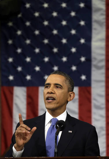 President Barack Obama gestures as he gives his State of the Union address during a joint session of Congress on Capitol Hill in Washington, Tuesday Feb. 12, 2013. (AP Photo/Charles Dharapak, Pool) ORG XMIT: CAP522