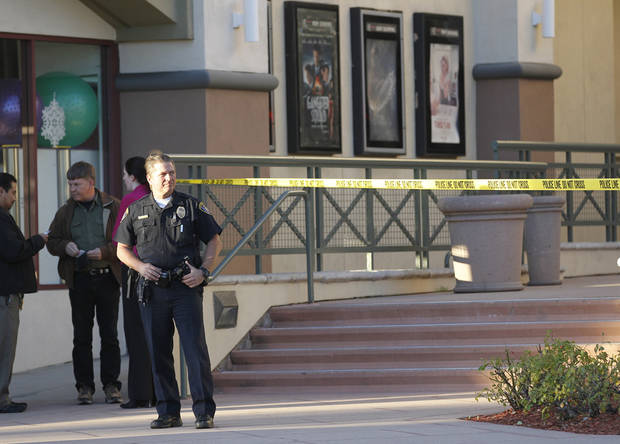 Police investigate a shooting at the Reading Cinemas in San Diego on Saturday evening, Jan. 12, 2013. Police shot and critically wounded a man suspected of chasing his girlfriend with a handgun after they found him hiding inside the movie theater. It was the second shooting at a San Diego County movie theater in as many days. (AP Photo/UT San Diego, Earnie Grafton)