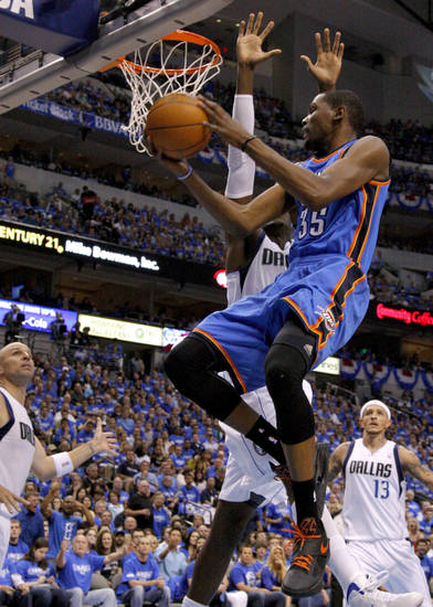 Oklahoma City's Kevin Durant (35) goes around Dallas' Shawn Marion (0) during Game 4 of the first round in the NBA playoffs between the Oklahoma City Thunder and the Dallas Mavericks at American Airlines Center in Dallas, Saturday, May 5, 2012. Photo by Bryan Terry, The Oklahoman