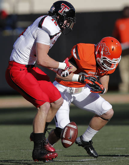 Texas Tech's Cody Davis (16) breaks up a pass for Oklahoma State's Blake Webb (85) during the college football game between the Oklahoma State University Cowboys (OSU) and Texas Tech University Red Raiders (TTU) at Boone Pickens Stadium on Saturday, Nov. 17, 2012, in Stillwater, Okla.   Photo by Chris Landsberger, The Oklahoman