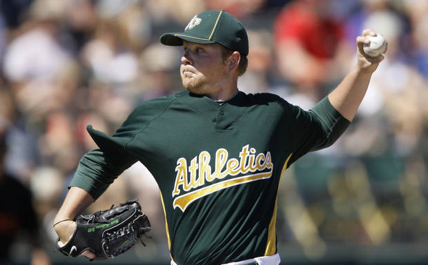 Oakland Athletics' Brett Anderson pitches against the San Francisco Giants  during the second inning of a spring training major league baseball game in Phoenix, Wednesday, March 17, 2010. (AP Photo/Jeff Chiu) ORG XMIT: AZJC102