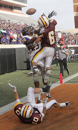 Clinton's Devon Mitchell (6) and Quinton Hand (10) break up a pass in the end zone for Anadarko's R.J. Sink (25) in the final seconds of the game during the Class 4A Oklahoma state championship football game between Anadarko and Clinton at Boone Pickens Stadium on Saturday, Dec. 1, 2012, in Stillwater, Okla.   Photo by Chris Landsberger, The Oklahoman
