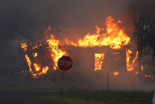 A home burns in Luther, Okla., after wildfire moved through the area on Friday, August 3, 2012. Photo by Bryan Terry, The Oklahoman