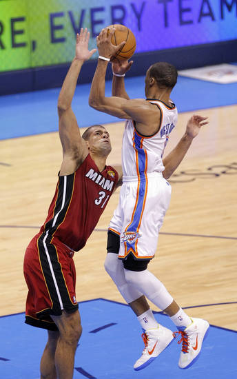 Oklahoma City's Russell Westbrook (0) passes the ball around Miami's Shane Battier (31) during Game 1 of the NBA Finals between the Oklahoma City Thunder and the Miami Heat at Chesapeake Energy Arena in Oklahoma City, Tuesday, June 12, 2012. Photo by Sarah Phipps, The Oklahoman