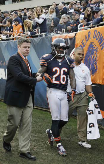 Chicago Bears cornerback Tim Jennings (26) is helped off the field by trainers after an injury in overtime of an NFL football game in Chicago, Sunday, Dec. 2, 2012. The Seahawks won 23-17 in overtime. (AP Photo/Nam Y. Huh)
