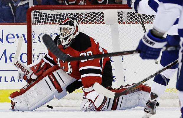 New Jersey Devils goalie Martin Brodeur is unable to stop a shot by Tampa Bay Lightning center Nate Thompson, not pictured, during the second period of an NHL hockey game, Thursday, Feb. 7, 2013, in Newark, N.J. (AP Photo/Julio Cortez)