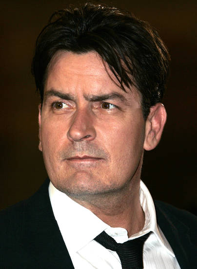"American actor Charlie Sheen arrives for the screening of the movie ""Platoon,"" at the 59th International film festival in Cannes, southern France, on Sunday, May 21, 2006.  (AP Photo/Kirsty Wigglesworth)"