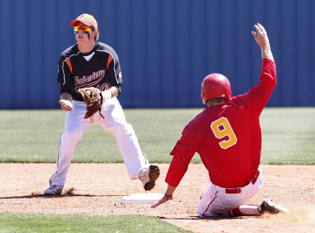 Dale's Landon Coon slides safely into second base below the tag of Fairview's Grant Nightengale during the class 2A state baseball game between Dale and Fairview at Dolese Park in Oklahoma City, OK, Thursday, May 10, 2012,  By Paul Hellstern, The Oklahoman