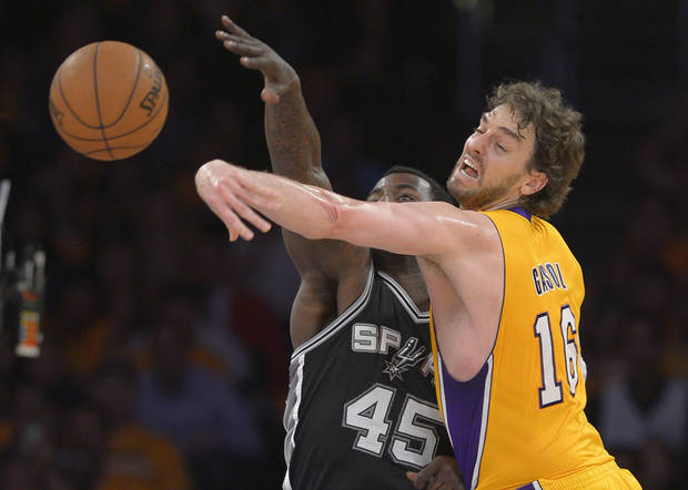 Los Angeles Lakers forward Pau Gasol, of Spain,, right, blocks a pass by San Antonio Spurs center DeJuan Blair during the first half in Game 3 of a first-round NBA basketball playoff series, Friday, April 26, 2013, in Los Angeles. (AP Photo/Mark J. Terrill)