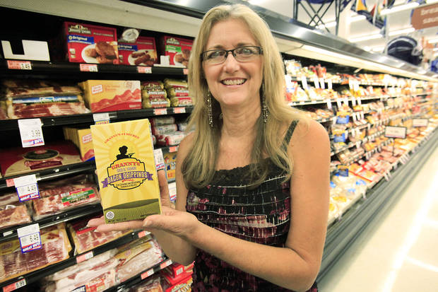 Jan Laub displays her product, Granny�s Good Ol� Fashion Bacon Drippings, which is being sold by some area Homeland stores and other Oklahoma groceries.  Photo by David McDaniel, The Oklahoman