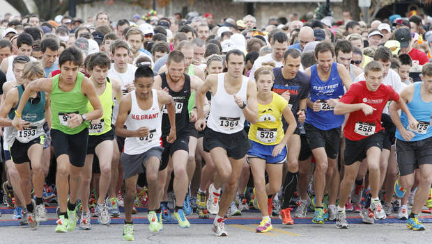 Runners start the 5K Turkey Trot in Edmond, Thursday  November 22, 2012. The annual Turkey Trot is a fundraiser for Turning Point Ministries. Photo By Steve Gooch, The Oklahoman