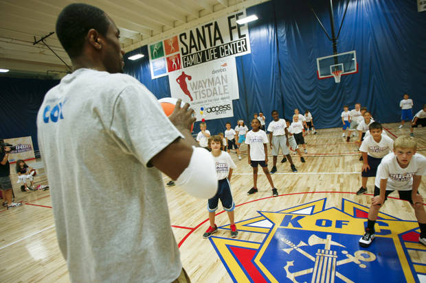 Serge Ibaka coaches kids on their reactions at the Thunder Youth Basketball Camp at the Santa Fe Family Life Center on Tuesday, June 14, 2011. Photo by Zach Gray, The Oklahoman