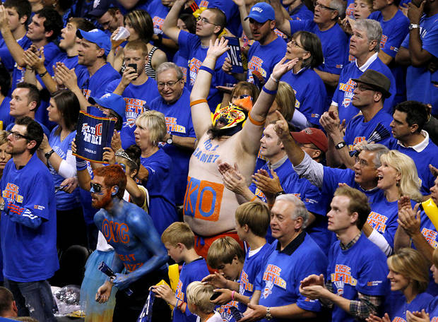 Oklahoma City fan Garrett Haviland (center) and other fans cheer for the Thunder during the second half of game 7 of the NBA basketball Western Conference semifinals between the Memphis Grizzlies and the Oklahoma City Thunder at the OKC Arena in Oklahoma City, Sunday, May 15, 2011. The Thunder beat the Grizzlies 105-90 to advance to the Western Conference finals against Dallas. Photo by John Clanton, The Oklahoman