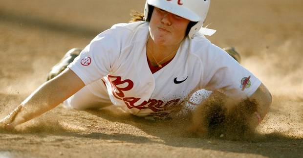 Alabama's Lisa Elizondo is tagged out at first base for a double play in the second inning of the Women's College World Series game between Alabama and the University of Michigan at the ASA Hall of Fame Stadium in Oklahoma City, Thursday, May 28, 2009. Photo by Bryan Terry, The Oklahoman