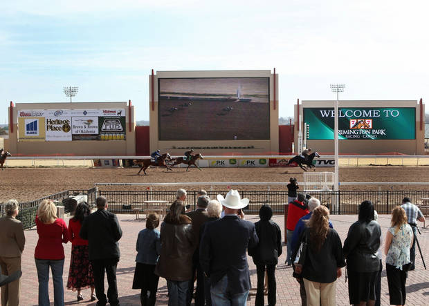 Crowds watch the debut of new high-definition video boards Thursday at Remington Park.