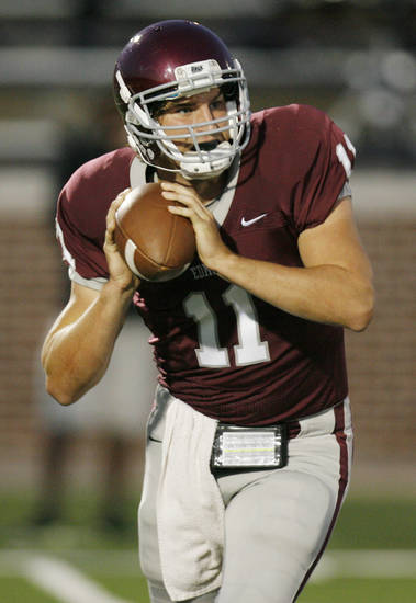 Edmond Memorial quarterback Ry Huff (11) looks to pass during a high school football game between Edmond Memorial and Moore at Wantland Stadium in Edmond, Okla., Thursday, Sept. 29, 2011. Photo by Nate Billings, The Oklahoman