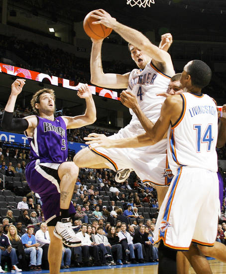 Oklahoma City's Nick Collison (4) grabs a rebound between Shaun Livingston (14), right, and Andres Nocioni (5) of Sacramento last week. The Thunder begins its season with the Kings tonight. Photo by Nate Billings, The Oklahoman