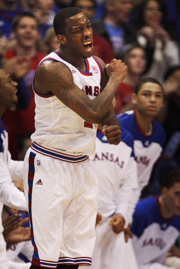 Kansas guard Tyshawn Taylor (10) celebrates a basket during the second half of an NCAA college basketball game against Oklahoma State in Lawrence, Kan., Saturday, Feb. 11, 2012. Kansas defeated Oklahoma State 81-66. (AP Photo/Orlin Wagner) ORG XMIT: KSOW108
