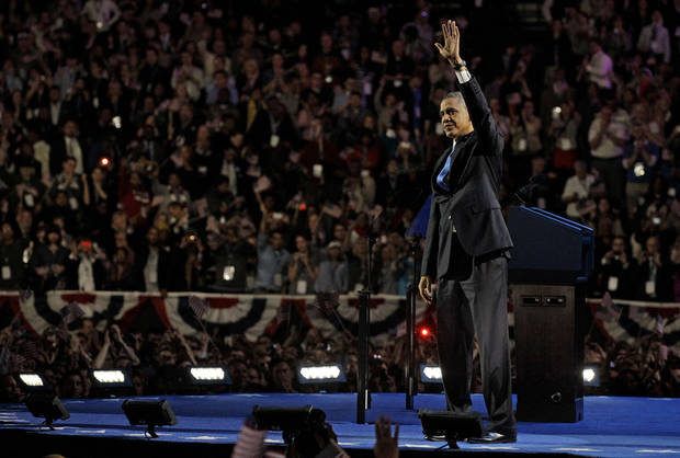 President Barack Obama waves to the crowd at his election night party Wednesday, Nov. 7, 2012, in Chicago. President Obama defeated Republican challenger former Massachusetts Gov. Mitt Romney. (AP Photo/M. Spencer Green)