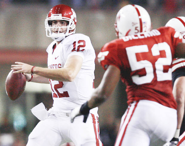 Oklahoma quarterback Landry Jones, left, threw five interceptions against Nebraska on Saturday. Photo by Chris Landsberger, The Oklahoman