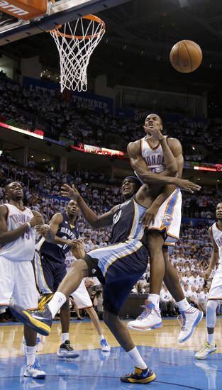 Oklahoma City's Serge Ibaka (9) defends against Memphis' Zach Randolph (50) during Game 5 in the second round of the NBA playoffs between the Oklahoma City Thunder and the Memphis Grizzlies at Chesapeake Energy Arena in Oklahoma City, Wednesday, May 15, 2013. Photo by Sarah Phipps, The Oklahoman