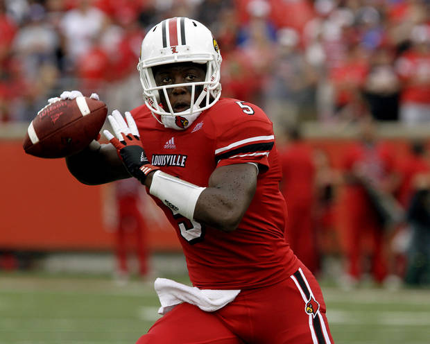 Louisville quarterback Teddy Bridgewater looks to pass against Kentucky during first-half action during an NCAA college football game at Cardinal Stadium in Louisville, Ky., Sunday, Sept. 2, 2012. (AP Photo/Garry Jones)