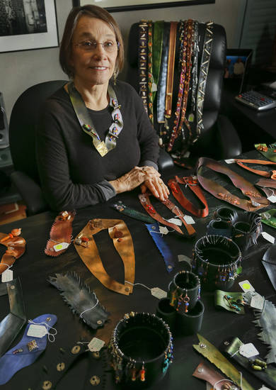 Sandra Schlezinger creates wearable art using innertubes from old tires. Photo by Chris Landsberger, The Oklahoman <strong>CHRIS LANDSBERGER</strong>
