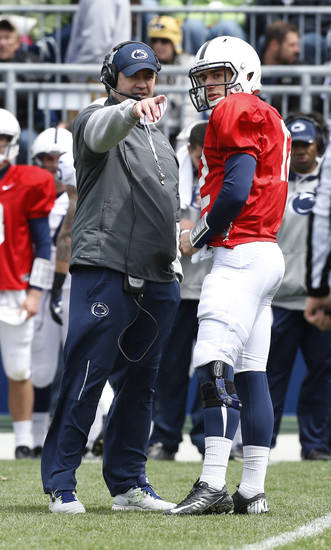 Penn State head coach Bill O'Brien, left, talks with quarterback Steven Bench (12) during the first half of their spring NCAA college football game on Saturday, April 20, 2013, in State College, Pa. (AP Photo/Keith Srakocic)