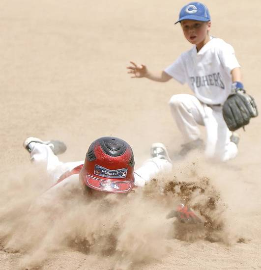 Gage Gilchrist takes a dive to the base during the USSSA World Series youth baseball tournament , Tuesday, July 12, 2011.  Photo by Ashley R. West, The Oklahoman ORG XMIT: KOD