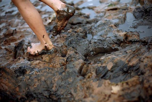 Justyce Samuels wades through mud as she plays with her friends on the shores of Lake Hefner in Oklahoma City on Tuesday, Sept. 7, 2010. Photo by John Clanton, The Oklahoman