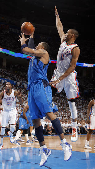 Oklahoma City's Russell Westbrook (0) defends against Dallas' Shawn Marion (0) during Game 2 of the first round in the NBA basketball playoffs between the Oklahoma City Thunder and the Dallas Mavericks at Chesapeake Energy Arena in Oklahoma City, Monday, April 30, 2012. Photo by Sarah Phipps, The Oklahoman