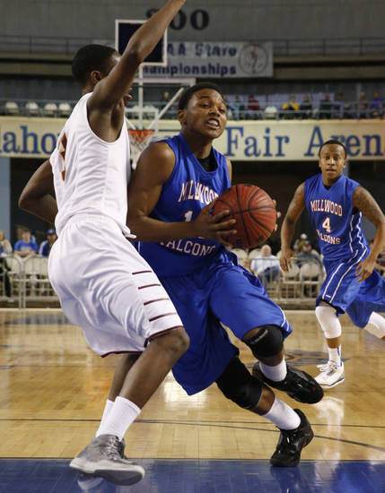 Millwood's Chris Cook drives past Malik Foxx during the 3A boys semifinal game between the Millwood High School Falcons and the Centennial Bison at the State Fair Arena on Friday, March 8, 2013 in Oklahoma City, Okla.  Photo by Steve Sisney, The Oklahoman