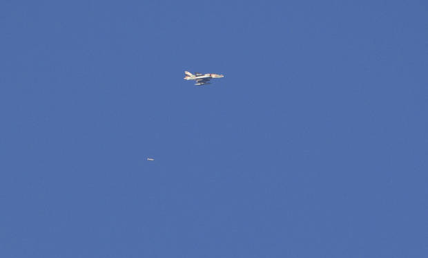 An Israel war plane drops a bomb over the northern Gaza Strip, seen from the Israel Gaza Border, southern Israel, Thursday, Nov. 15, 2012. (AP Photo/Ariel Schalit)