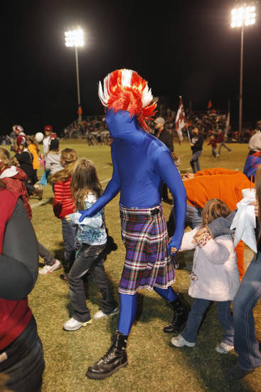 Wynnewood Savage fan Jamie Weaver leaves the field after his team's entrance as the Wayne Bulldogs play the Wynnewood Savages in District 5, Class A high school football on Friday, Oct. 28, 2011, in Wayne, Okla.    Photo by Steve Sisney, The Oklahoman