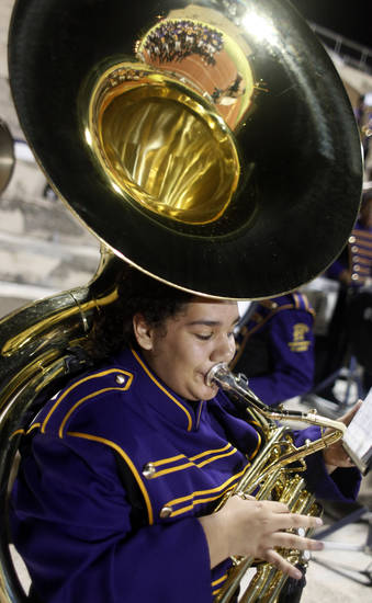 The NWC players are reflected in the bell of a tuba after the game at the Northwest Classen vs. Western Heights high school football game at Taft Stadium Thursday, September 20, 2012. Photo by Doug Hoke, The Oklahoman