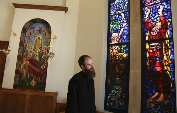 The Rev. Jeremy Davis walks through the sanctuary at St. Elijah Antiochian Orthodox Christian Church, 15000 N May, which features iconography and stained-glass windows.  <strong>Garett Fisbeck - Garett Fisbeck</strong>