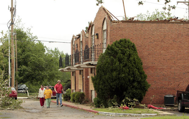 Left: Several residents of West Oaks Apartments, 917 24th Ave. SW, were left homeless Friday when a tornado ripped the roof off their apartment units.  PHOTOS BY STEVE SISNEY,  THE OKLAHOMAN